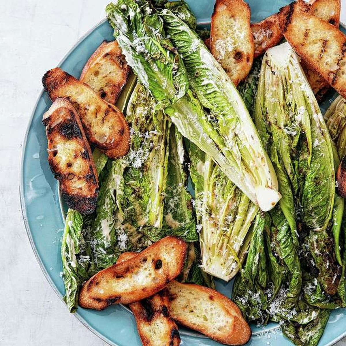 Grilling romaine lettuce adds smoky flavor to a traditional Caesar salad.