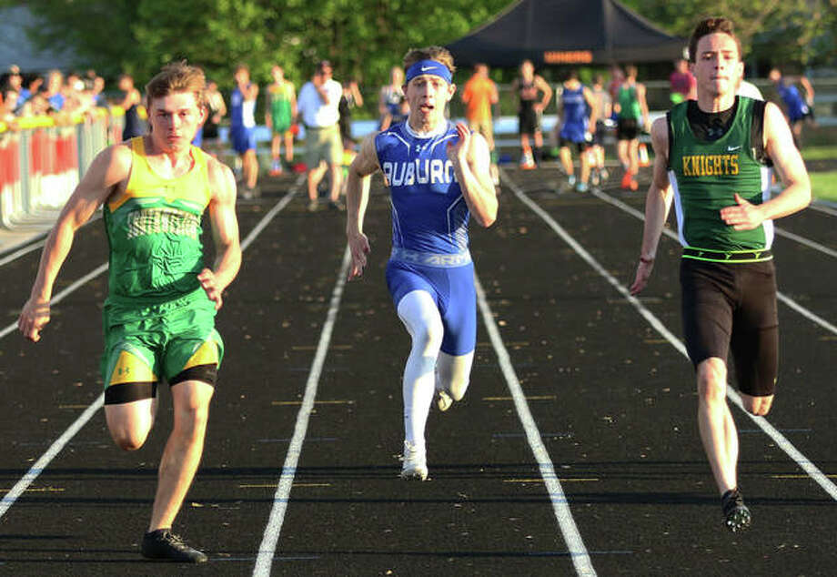 Southwestern's E.J. Kahl (left) beats Metro East Lutheran's Jack Bircher (right) and Auburn's Greg Downs to the finish in the 100 meters Thursday at the Gillespie Class 2A Sectional. Kahl won the race in 11.16 seconds and all three runners advance to state. Photo: Hearst Newspapers