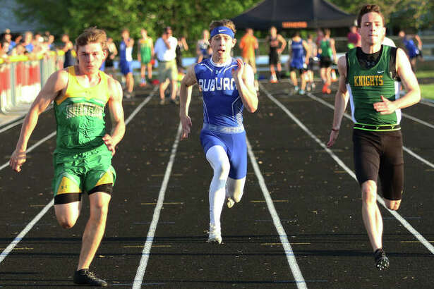 Southwestern's E.J. Kahl (left) beats Metro East Lutheran's Jack Bircher (right) and Auburn's Greg Downs to the finish in the 100 meters Thursday at the Gillespie Class 2A Sectional. Kahl won the race in 11.16 seconds and all three runners advance to state.