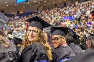 Norwalk Early College Academy (NECA) graduates Julia Turek and Derick Ruiz at Norwalk Community College's May 21, 2019 graduation ceremony, at Webster Bank Arena, in Bridgeport, Conn.