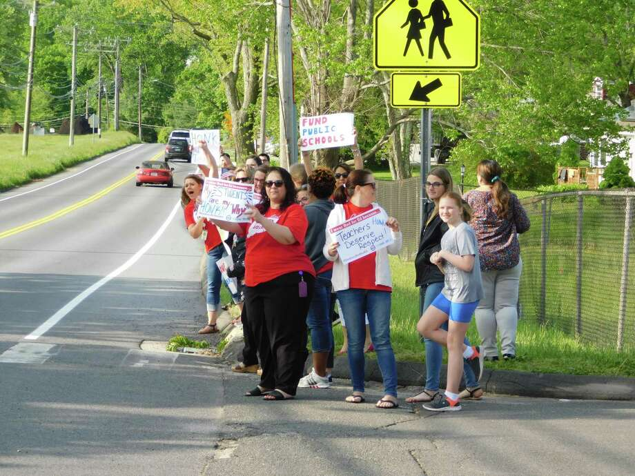 Educators gathered outside Pembroke Elementary School in Danbury the morning of Wednesday, May 22, 2019, to protest the lack of funding for the city's public schools. Photo: Kendra Baker / Hearst Connecticut Media