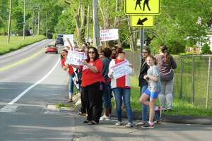 Educators gathered outside Pembroke Elementary School in Danbury the morning of Wednesday, May 22, 2019, to protest the lack of funding for the city's public schools.