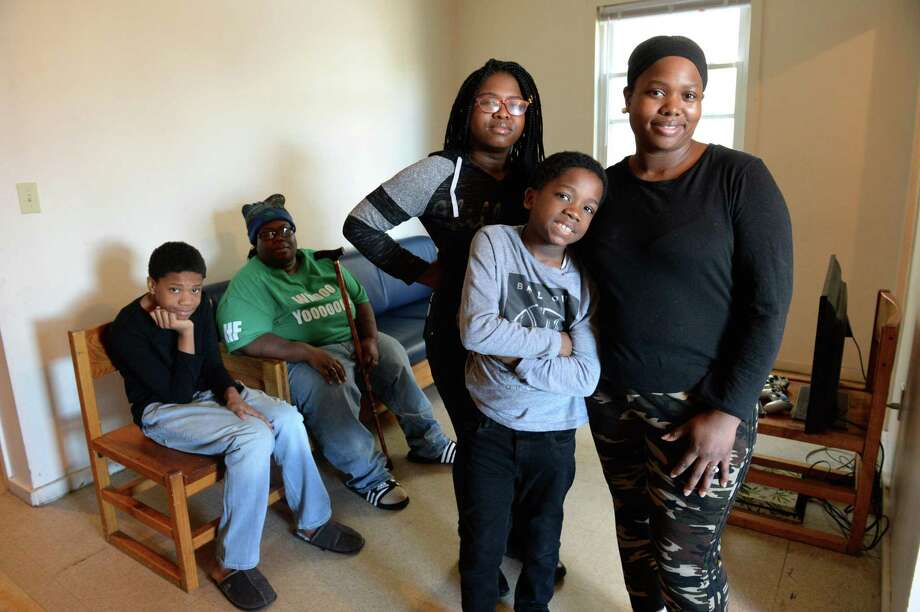 Ashana Cunningham lives with her wife, India Cunningham and her three children - Ansoneya Mitchener, 15, Robert Hallums, 12 and Brandon Mitchener, 9 - in a three-bedroom apartment in a Bridgeport shelter. Cunningham fell on hard times after being injured in a car accident that totaled her car. She had to quit her job after a two-week hospital stay and now works part-time at a day care center for $12.50 per hour. Cunningham is looking for a better paying job and affordable housing for her family. Photo: Cloe Poisson / CTMirror.org / Cloe Poisson