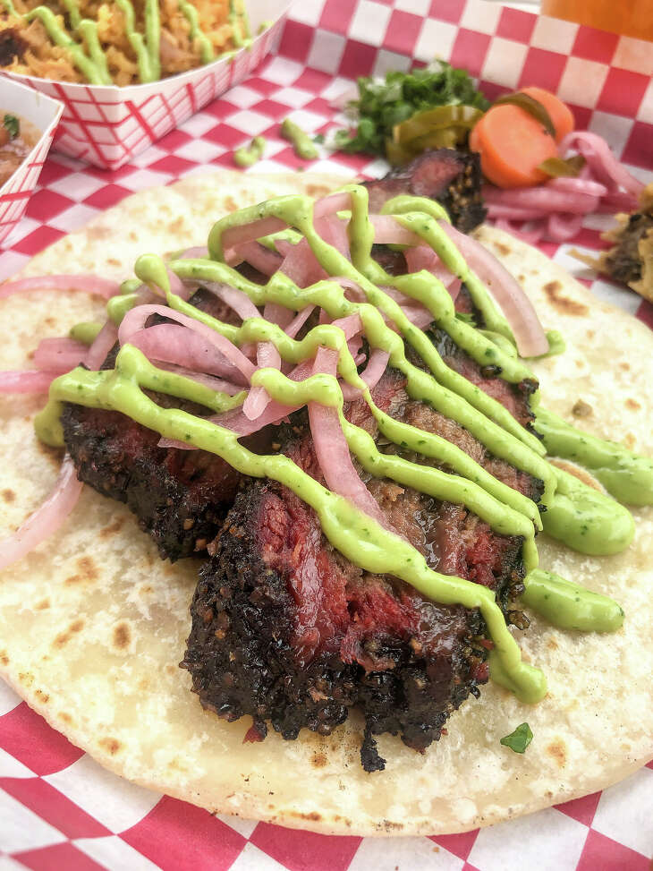 The Houston Barbecue Festival has announced its first Tex-Mex BBQ Block Party, to be held July 14 at Saint Arnold Brewing Co. The festival will celebrate Tejano and Tex-Mex influence on craft barbecue. Shown: Smoked beef cheek taco with pickled onions and verde sauce from JQ's Tex Mex BBQ.