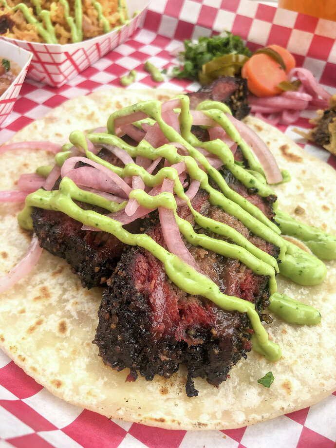 The Houston Barbecue Festival has announced its first Tex-Mex BBQ Block Party, to be held July 14 at Saint Arnold Brewing Co. The festival will celebrate Tejano and Tex-Mex influence on craft barbecue. Shown: Smoked beef cheek taco with pickled onions and verde sauce from JQ's Tex Mex BBQ. Photo: Houston Barbecue Festival