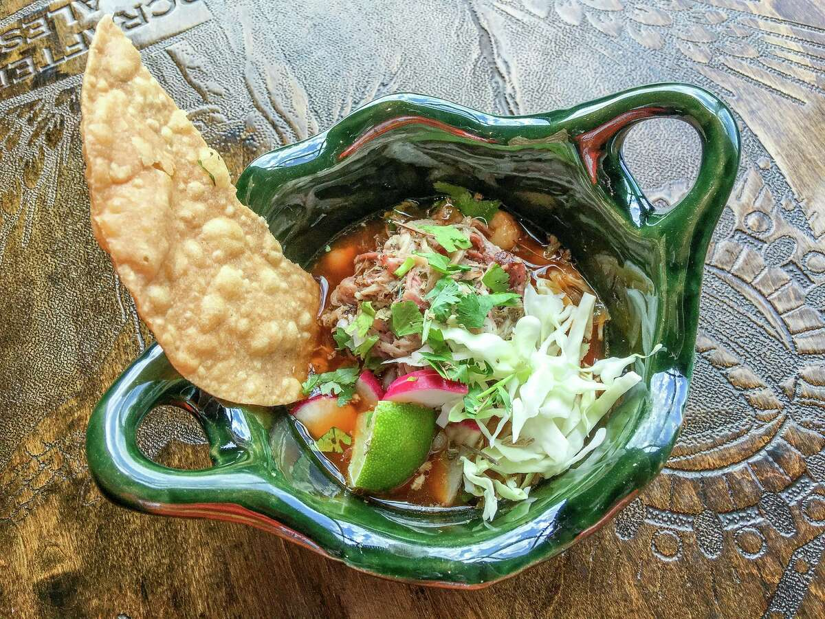 The Houston Barbecue Festival has announced its first Tex-Mex BBQ Block Party, to be held July 14 at Saint Arnold Brewing Co. The festival will celebrate Tejano and Tex-Mex influence on craft barbecue. Shown: Smoky pozole with smoked pork shoulder from El Burro & the Bull.