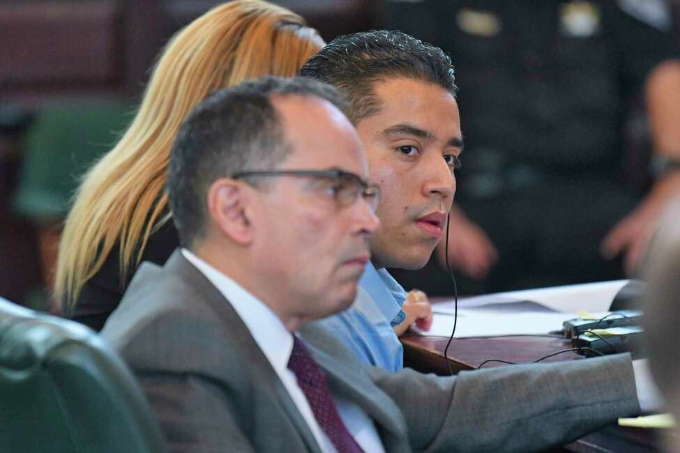 Defense attorney, Jay Hernandez III, left, and defendant, Luis Alfredo Monge Guevara, listen to opening statements by the prosecution during Guevara's murder trial at Rensselaer County Court on Wednesday, May 22, 2019, in Troy, N.Y. (Paul Buckowski/Times Union)