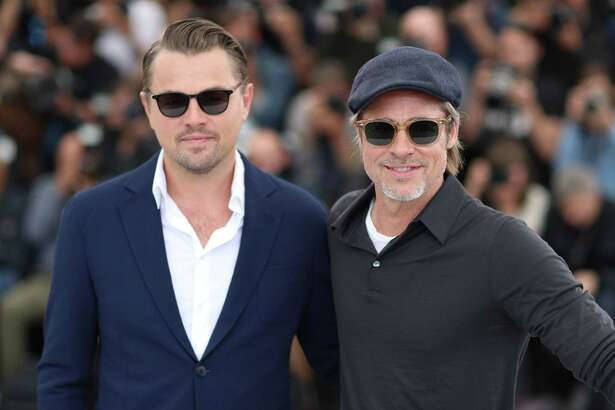 "TOPSHOT - US actor Leonardo DiCaprio (L) and US actor Brad Pitt pose during a photocall for the film ""Once Upon a Time... in Hollywood"" at the 72nd edition of the Cannes Film Festival in Cannes, southern France, on May 22, 2019. (Photo by Valery HACHE / AFP)VALERY HACHE/AFP/Getty Images"