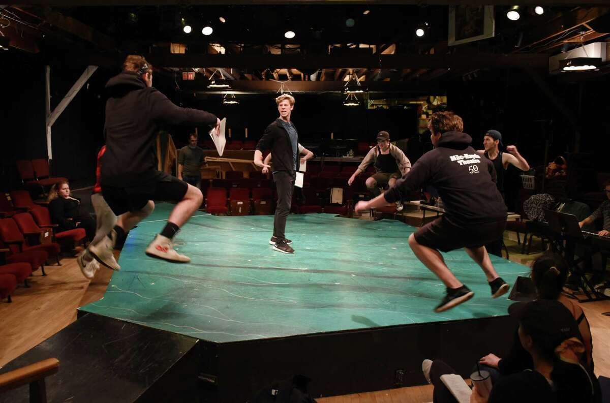 Actors - including Gino Cardoni, center - rehearse a musical number for the upcoming production of