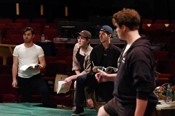 """Actors take notes during a rehearsal for the upcoming production of """"Camelot."""""""
