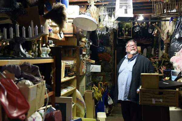 """Producing artistic director John Saunders looks at various items in the """"props cave"""" at the Mac-Haydn. (Phoebe Sheehan/Times Union)"""