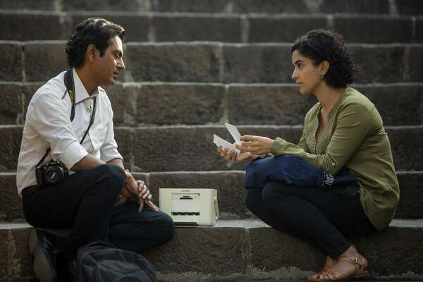 "Nawazuddin Siddiqui, left, and Sanya Malhotra in ""Photograph."" MUST CREDIT: Joe D'Souza, Amazon Studios"