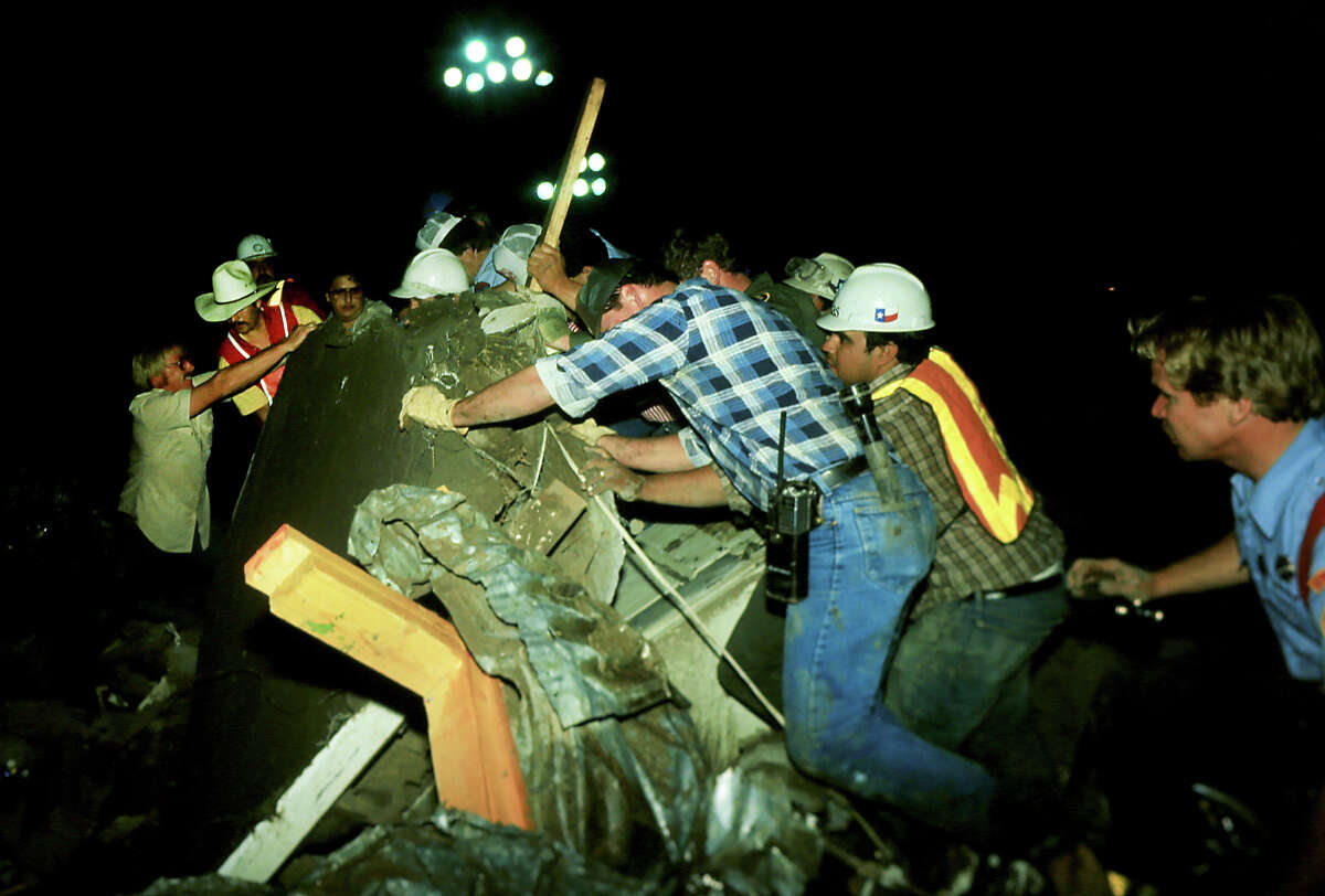 Rescue crews searched well in to the early morning hours at the Catholic Hall of Our Lady of Guadalupe Church where 22 men, women and children died May 22, 1987 in Saragosa.