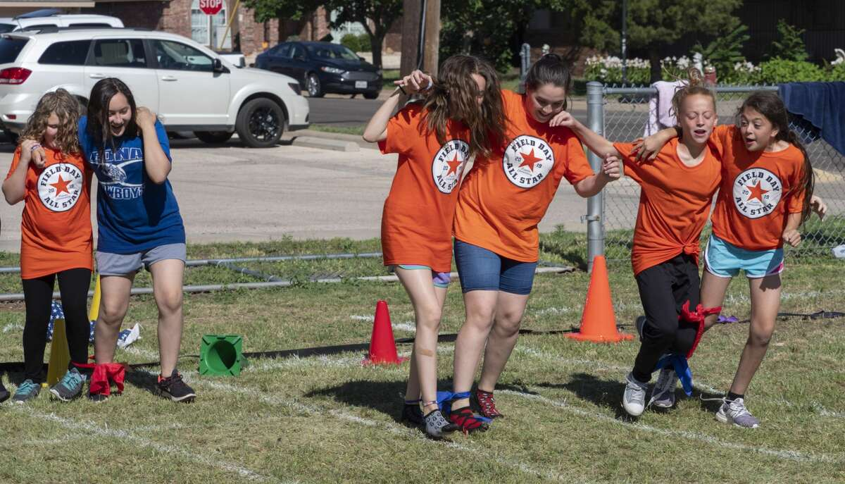 General Franks Elementary students run the three legged race 05/22/19 as students participate in field day fun. Tim Fischer/Reporter-Telegram