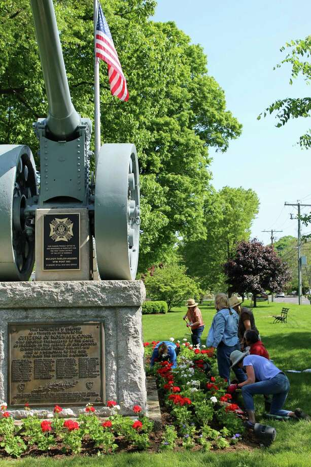 Members of the Norwalk Garden Club planted flowers on the Green on Wednesday morning to get it looking sharp for Memorial Day. They planted red and white begonias and blue ageratum around and near the cannon memorial.The club used new tools obtained through a grant from the Ames Tool Co. Learn more about the club at norwalkgardenclub.com. Photo: Thane Grauel / Hearst Connecticut Media / Connecticut Post