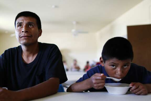 LAS CRUCES, NM - MAY 16:  Central American migrants, a father and son,  sit in a shelter for migrants who seek asylum on May 16, 2019 in Las Cruces, New Mexico. After being released by the U.S. Immigration and Customs Enforcement (ICE) to the shelter, asylum-seekers are then normally transferred from the shelter to their U.S. sponsors as they await their asylum requests. Approximately 1,000 migrants per day are being released by authorities in the El Paso sector of the U.S.-Mexico border, which includes Las Cruces. Las Cruces has processed over 5,000 asylum seekers since it began receiving them from the Border Patrol on April 12. President Trump presented a new immigration plan in a White House Rose Garden speech today.  (Photo by Mario Tama/Getty Images)