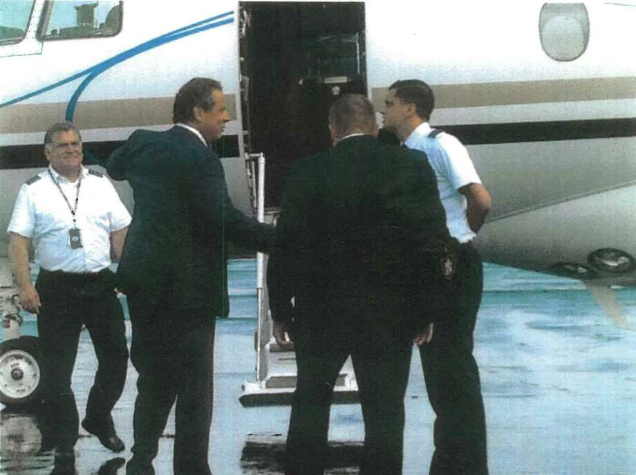 Gov. Andrew Cuomo boards a flight on a plane operated by a company owned by Adam Katz. The undated photo was obtained by the Times Union.