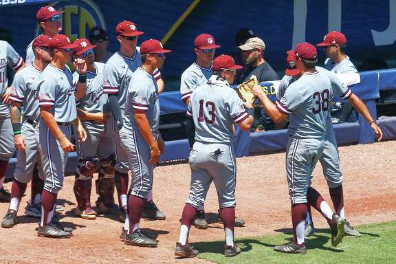 Texas A&M pitcher Chris Weber (38) is greeted by teammates after being relieved in the eighth inning of the Southeastern Conference tournament NCAA college baseball game against Georgia, Wednesday, May 22, 2019, in Hoover, Ala. (AP Photo/Butch Dill)