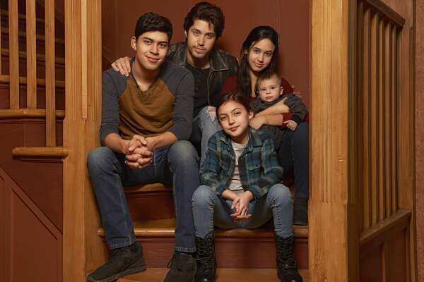 """This image released by Freeform shows the cast of """"Party of Five,"""" Niko Guardado as Beto Buendia, left, Brandon Larracuente as Emilio Buendia, Elle Paris Legaspi as Valentina Buendia, foreground right, and Emily Tosta as Lucia Buendia. The reboot of the 1990s teen drama centers on a Mexican American family whose parents were deported to Mexico. (Vu Ong/Freeform via AP)"""