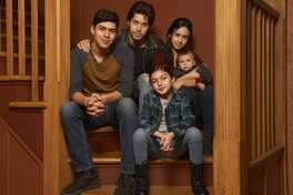 "This image released by Freeform shows the cast of ""Party of Five,"" Niko Guardado as Beto Buendia, left, Brandon Larracuente as Emilio Buendia, Elle Paris Legaspi as Valentina Buendia, foreground right, and Emily Tosta as Lucia Buendia. The reboot of the 1990s teen drama centers on a Mexican American family whose parents were deported to Mexico. (Vu Ong/Freeform via AP)"