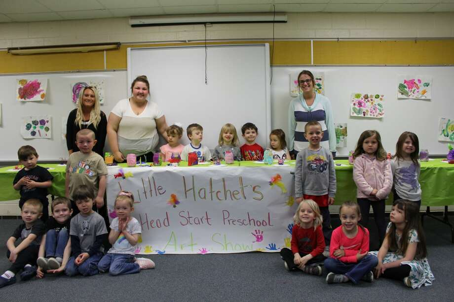 Kids that are part of the Head Start Pre-K program show off their artwork. Parents and Bad Axe Elementary School students looked around as well. Photo: Robert Creenan/Huron Daily Tribune