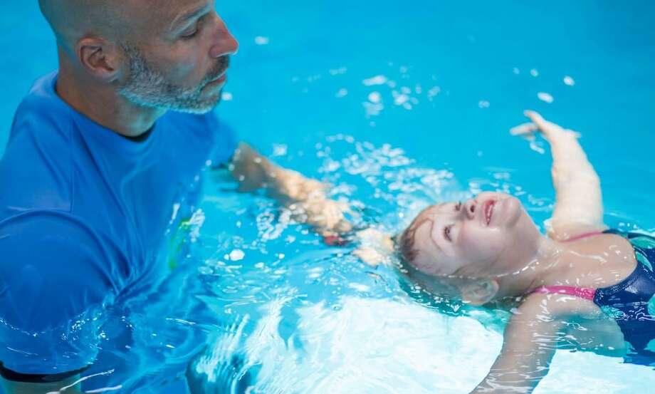 A survival swimming instructor teaches a child how to float in a pool. Photo: Courtesy Of Parents Preventing Childhood Drowning