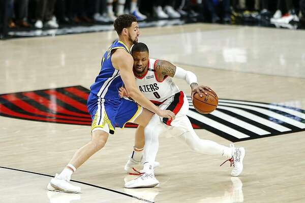 PORTLAND, OREGON - MAY 20: Damian Lillard #0 of the Portland Trail Blazers dribbles against Klay Thompson #11 of the Golden State Warriors during the first half in game four of the NBA Western Conference Finals at Moda Center on May 20, 2019 in Portland, Oregon. NOTE TO USER: User expressly acknowledges and agrees that, by downloading and or using this photograph, User is consenting to the terms and conditions of the Getty Images License Agreement. (Photo by Jonathan Ferrey/Getty Images)