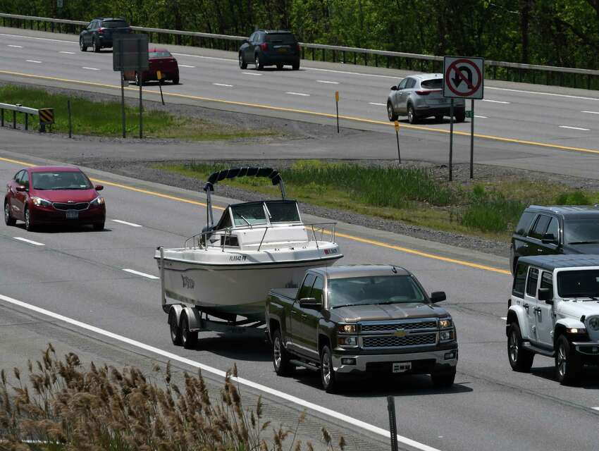 A pleasure boat is towed up he Northway ahead of the Memorial Day weekend on Wednesday, May 22, 2019, in Halfmoon, N.Y. (Will Waldron/Times Union)