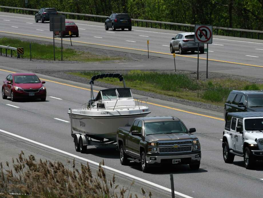 A pleasure boat is towed up he Northway ahead of the Memorial Day weekend on Wednesday, May 22, 2019, in Halfmoon, N.Y.  (Will Waldron/Times Union) Photo: Will Waldron, Albany Times Union / 20047016A
