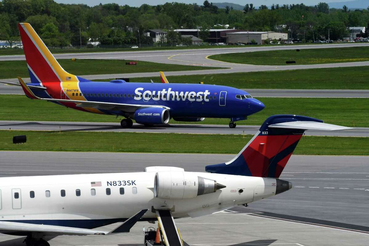 At least seven flights from Albany International Airport were delayed or canceled Tuesday because of weather.