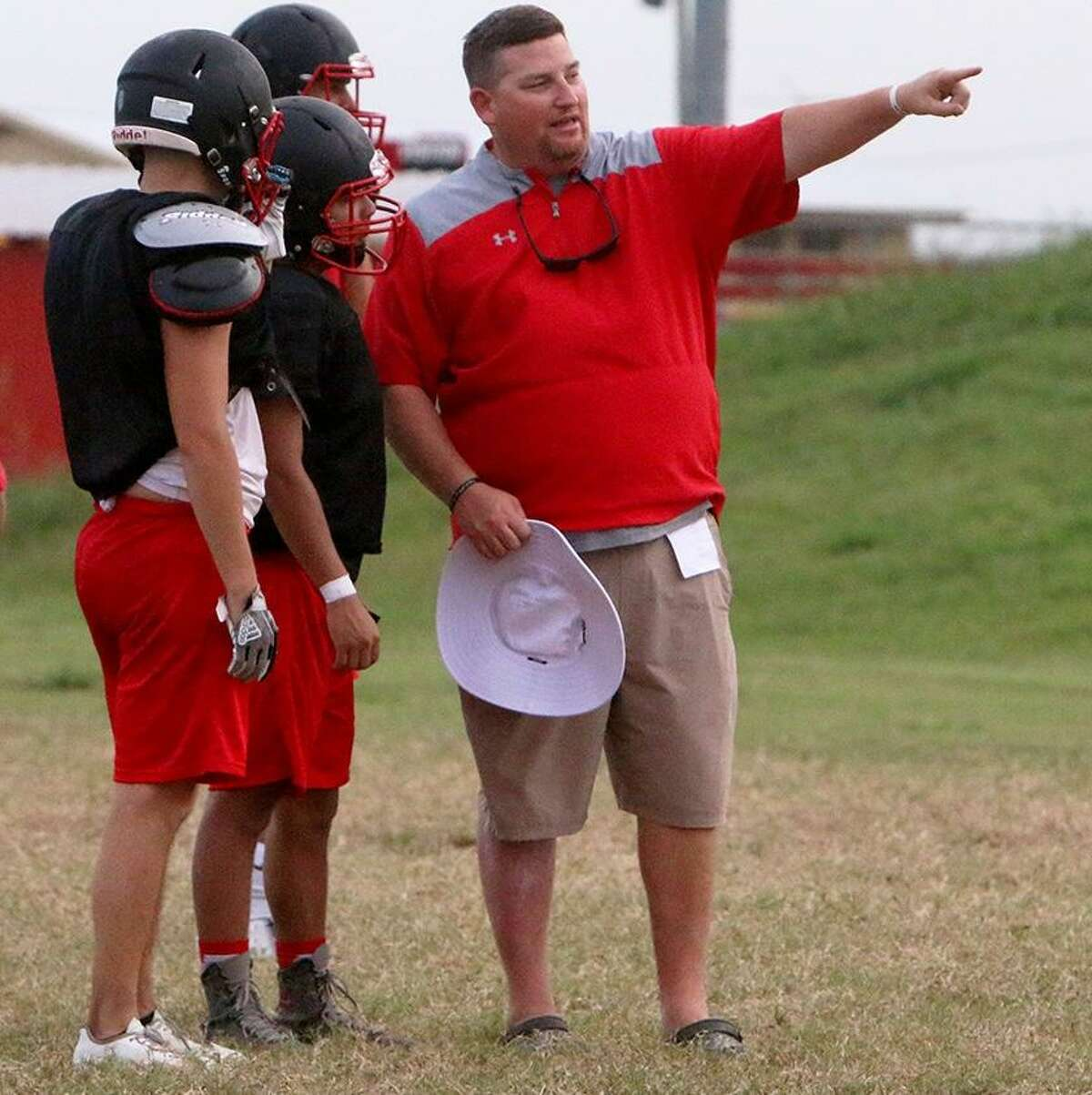 Ned Barrier, shown here last August with his old team, Wallis Brazos, is the new head football coach and campus athletics coordinator at Caney Creek High School.