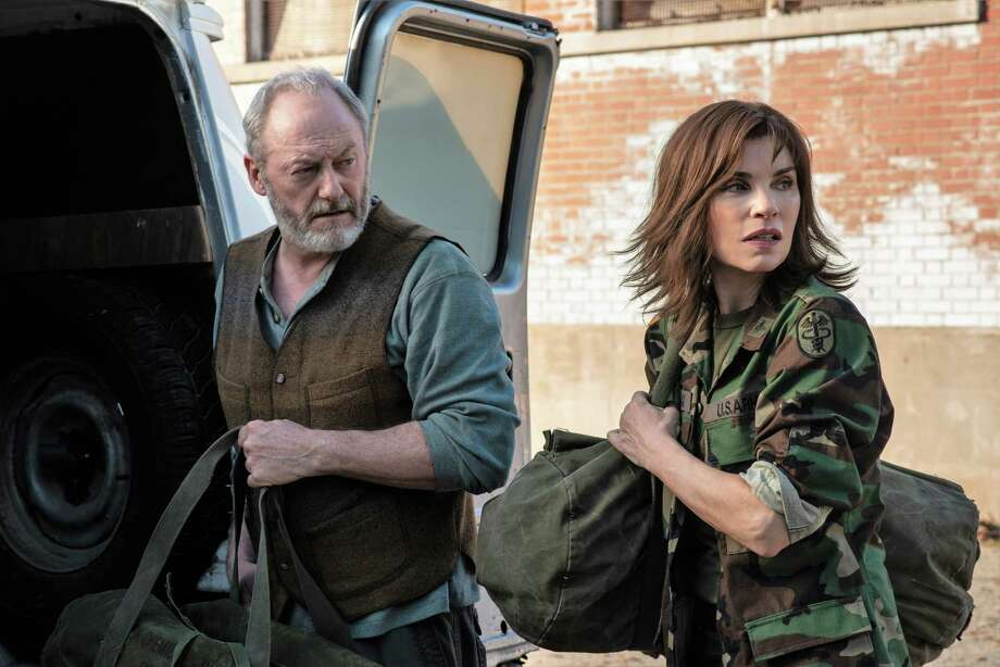 "Nancy Jaax (Julianna Margulies) and Wade Carter (Liam Cunningham) team up in ""The Hot Zone."" Photo: Amanda Matlovich, Photographer / National Geographic/Amanda Matlovich / National Geographic"