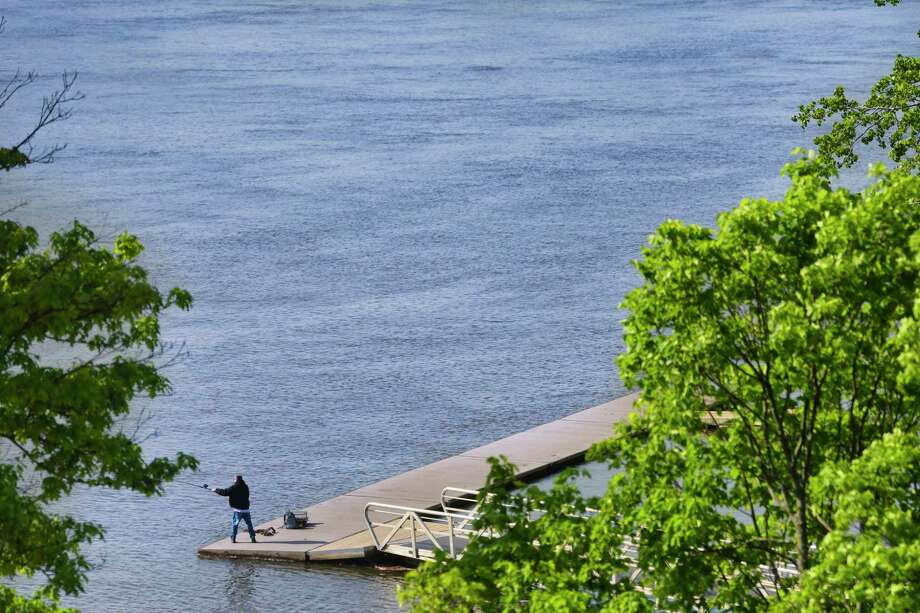 A man fishes from a dock on the Hudson River in Hudson Shores Park on Wednesday, May 22, 2019, in Watervliet, N.Y.  (Paul Buckowski/Times Union) Photo: Paul Buckowski, Albany Times Union / (Paul Buckowski/Times Union)