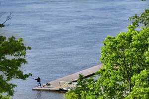 A man fishes from a dock on the Hudson River in Hudson Shores Park on Wednesday, May 22, 2019, in Watervliet, N.Y.  (Paul Buckowski/Times Union)