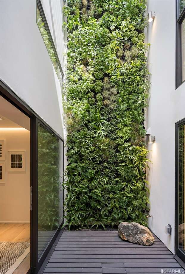 The centerpiece of the home is the three-floor atrium with living wall. Photo: Adam Potts Photography