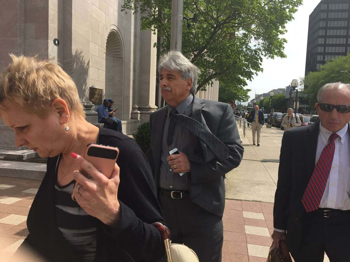 Daniel Lion, center, pleaded guilty to one count of wire fraud Wednesday in U S. District Court for embezzling more than $100,000 from the city of New Haven in May. His wife is at left. His attorney, Jake Donovan, is at right.