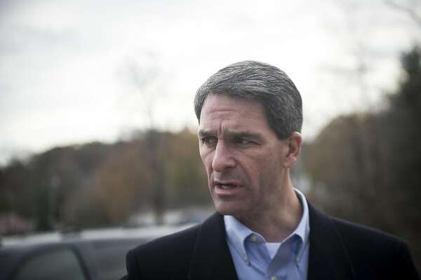 FILE -- Ken Cuccinelli, the former attorney general of Virginia and then-Republican candidate for governor, greets voters on their way to a polling place in Clifton, Va., on Election Day, Nov. 5, 2013. President Donald Trump is expected to name Cuccinelli, an immigration hard-liner, as his choice to coordinate the administration's immigration policies, a White House official confirmed on Tuesday, May 21, 2019. (Gabriella Demczuk/The New York Times)