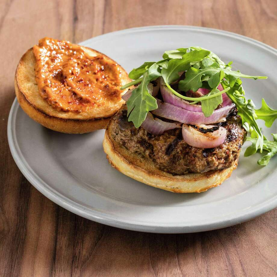 Grilled Harissa Lamb Burgers in Brookline, Mass. This recipe appears in the cookbook ?The Ultimate Burger.? (Daniel J. van Ackere/America's Test Kitchen via AP) Photo: Daniel J. Van Ackere / © 2018 America's Test Kitchen, LLC. All Rights Reserved.