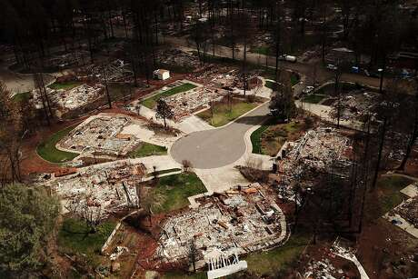The flattened homes at Mountain Meadow Court at Country Oak Drive, Friday, April 26, 2018, in Paradise, Calif.