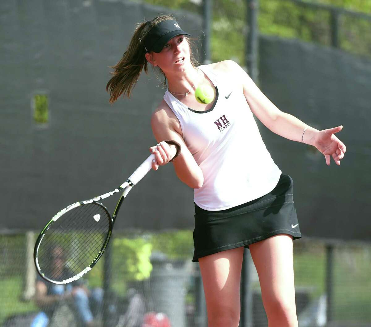 North Haven's Julia Migliorini hits a forehand against Hand's Sam Riordan on May 6.