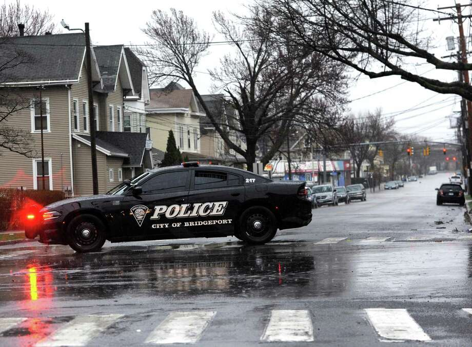 A police vehicle blocks cars from traveling down a flooded Norman Street in Bridgeport, Conn. on Monday, April 16, 2018. Excessive runoff from heavy rainfall caused flooding in many areas. Photo: Cathy Zuraw / Hearst Connecticut Media / Connecticut Post