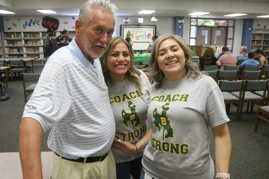 Longtime Park View coach Elton Blanchard shares a fun moment with Park View staffers Juanita Villarreal and Monica Ledezma.during his retirement party in the school's library. Photo: Robert Avery
