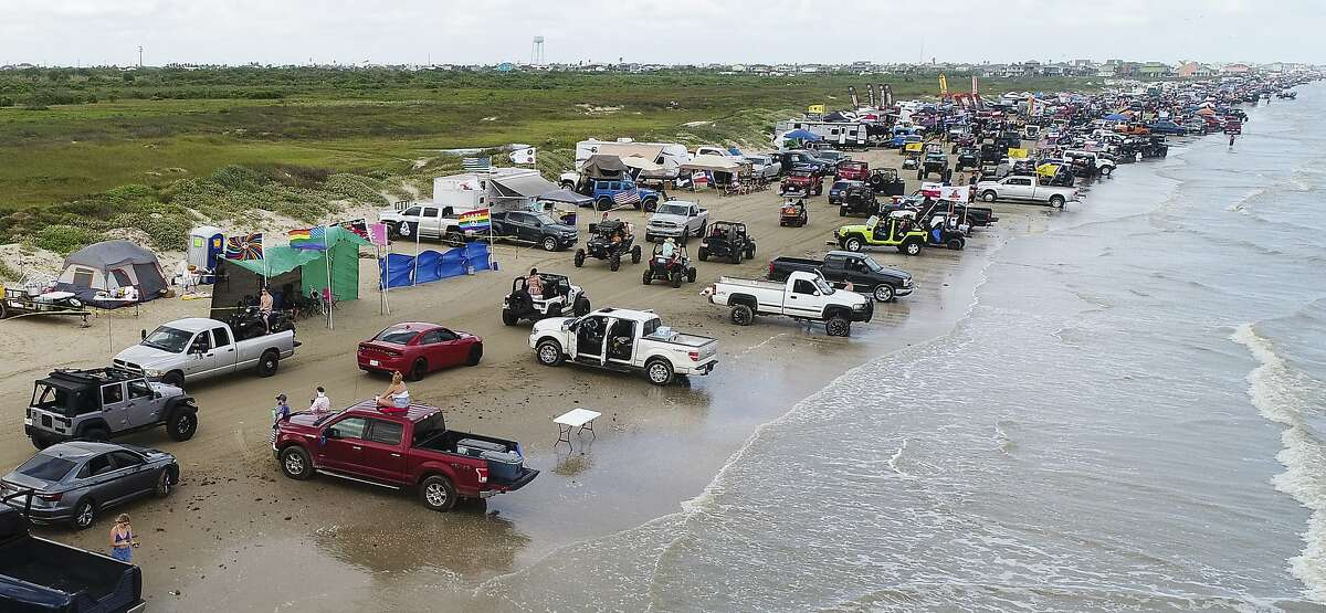 Jeeps, trucks and ATV's crowd Crystal Beach during the annual Go Topless Jeep weekend in Crystal Beach on Friday. Photo taken on Friday, 05/17/19. Ryan Welch/The Enterprise