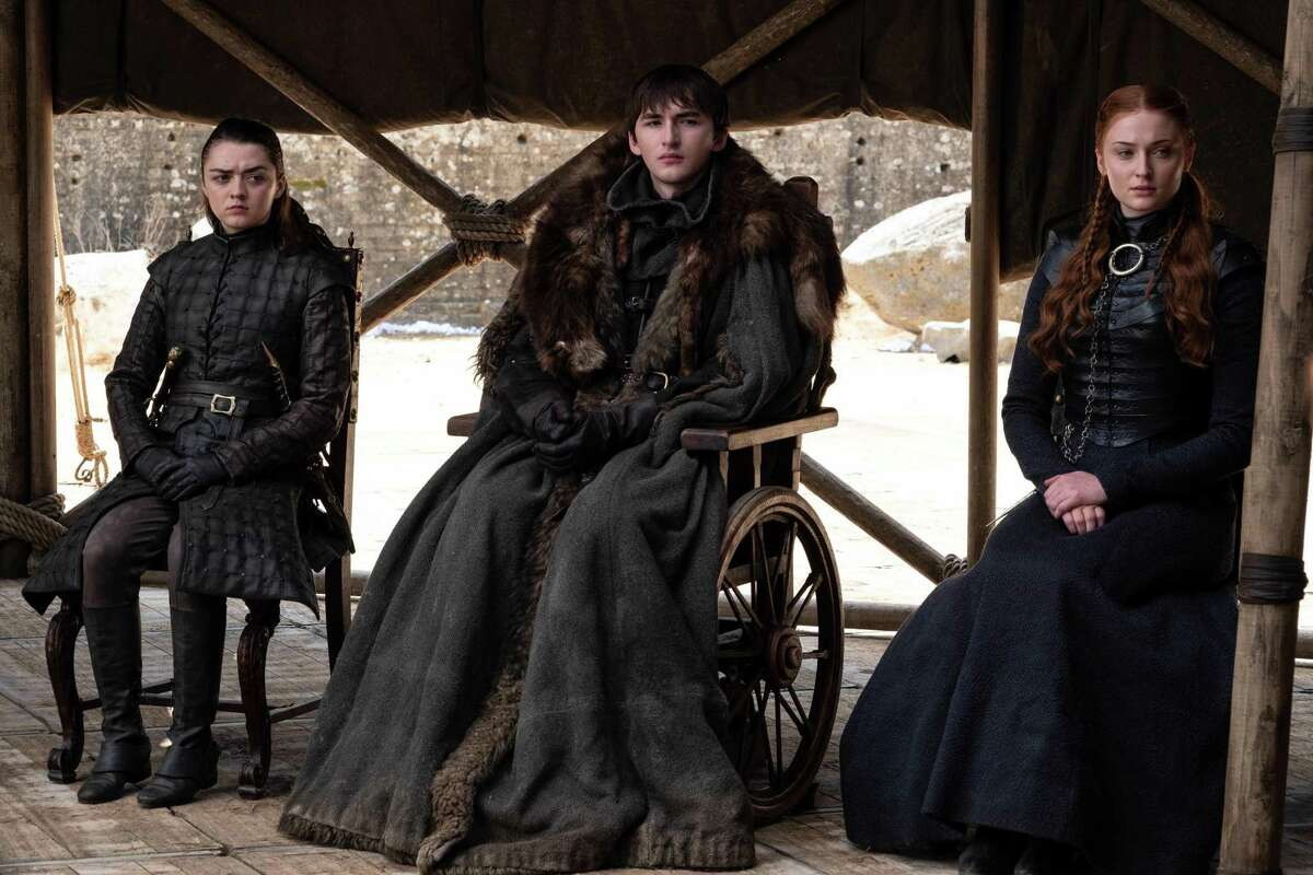 """Arya, Bran and Sansa Stark in the finale of 'Game of Thrones,' """"The Iron Throne,"""" on Sunday. (Helen Sloan/HBO/TNS)"""