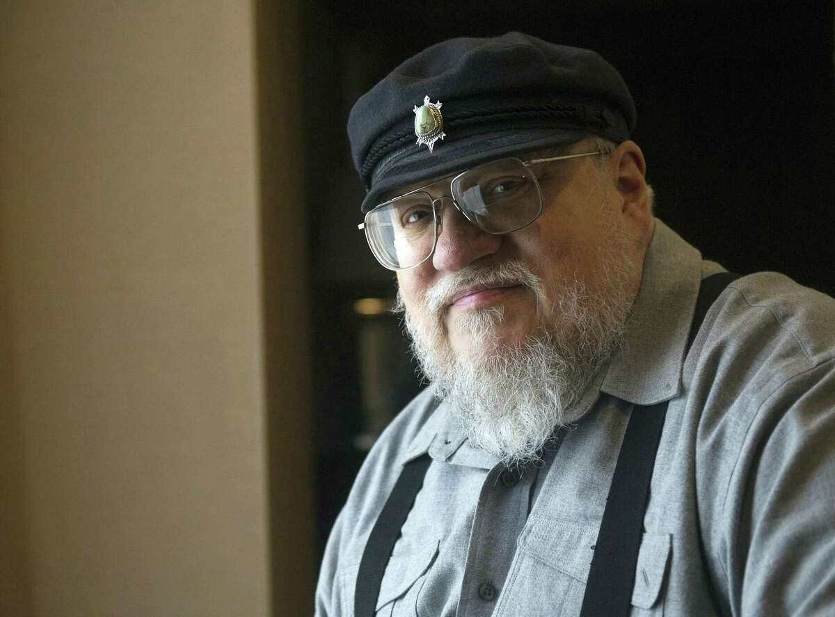 """FILE - In this March 12, 2012 file photo, George R.R. Martin, author of the popular book series """"A Song of Ice and Fire,"""" poses in Toronto. The author whose work was adapted into the HBO's series """"Game of Thrones,"""" which drew a record-setting numbers of viewers for its finale on Sunday, May 19, 2019, says it's """"been a wild ride."""" Martin wrote on Monday, May 20 that it """"was an ending, but it was also a beginning."""" The 70-year-old says he's working on the next installment, """"The Winds of Winter."""" (Nathan Denette/The Canadian Press via AP, File)"""