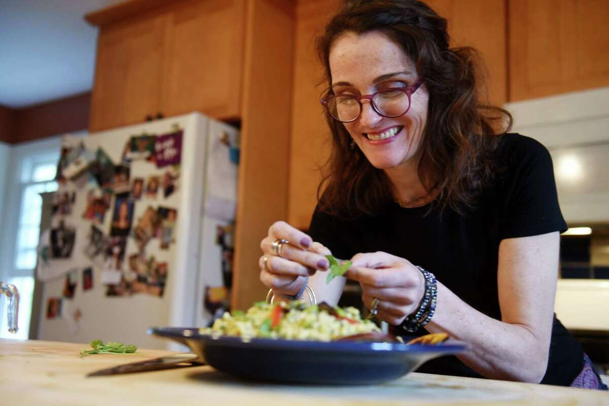 Caroline Barrett prepares a Moroccan pasta salad at her home on Wednesday, May 15, 2019, in Delmar, N.Y. (Will Waldron/Times Union)
