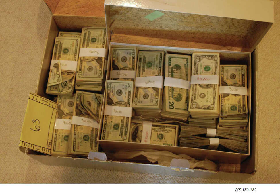 Evidence photos show some of the evidence, including more than $520,000 in cash, that federal task force members retrieved from NXIVM President Nancy Salzman's residence on Oregon Trail in Halfmoon, N.Y., in March 2018. (U.S. Department of Justice)