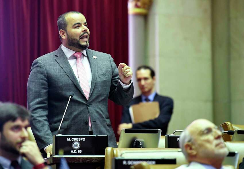 Assemblyman Marcos Crespo, D-Bronx, speaks in favor of legislation that authorizes state tax officials to release, if requested, individual New York state tax returns to Congress during a vote in the Assembly Chamber at the state Capitol Wednesday, May 22, 2019, in Albany, N.Y.