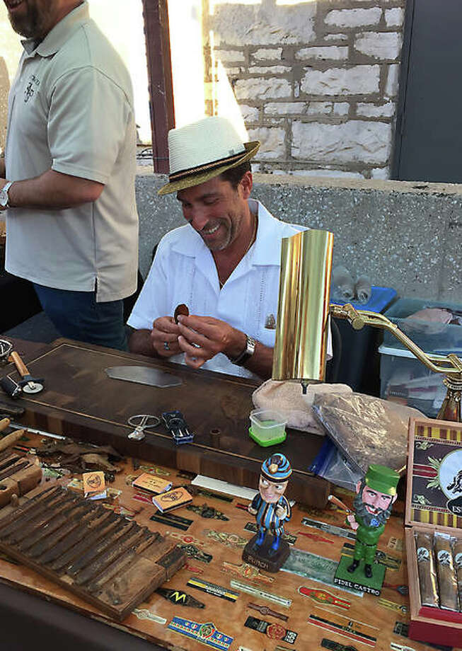 Scott Biancardi of STL Cigars is seen hand-rolling cigars during the first Hand Rolled Cigar Networking Event in 2017 outside of Bluff City Grill on Broadway in Alton. This year marks the third year for the event presented by Derrick and Kathleen Richardson of Alton. Photo: Photos Courtesy Of Derrick Richardson