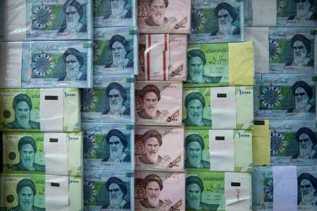 Iranian rial banknotes stand on display at a currency exchange in Tehran, Iran, on Saturday, May 18, 2019. President Donald Trump warned Iran not to threaten the U.S. or face ruinous consequences as tensions mount between Washington and Tehran.